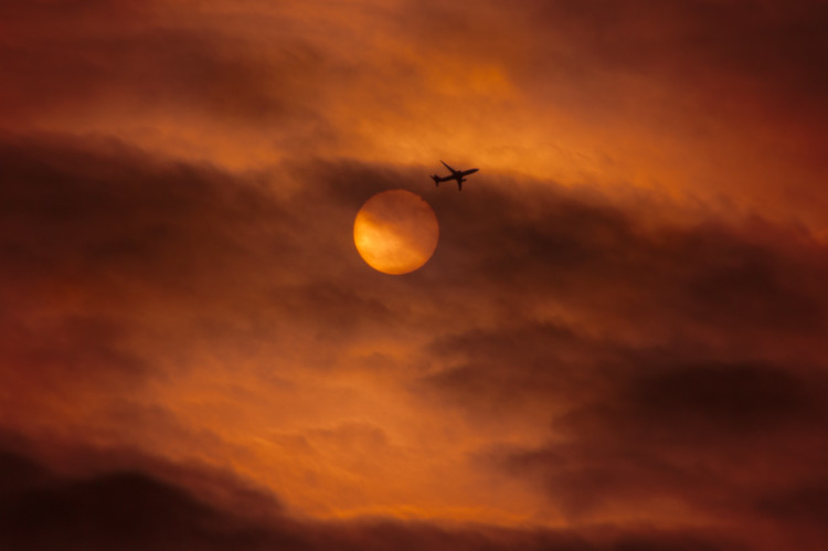Venus Eclipse and a passenger airliner